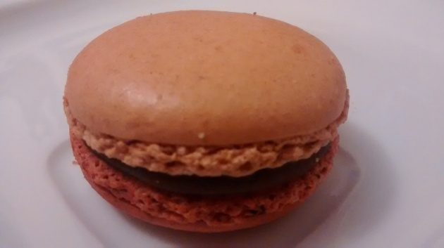 Chocolate and peanut butter macaron from side